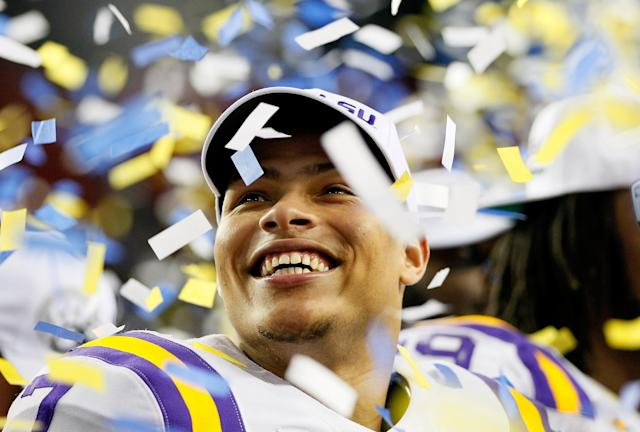 ATLANTA, GA - DECEMBER 03: Tyrann Mathieu #7 of the LSU Tigers celebrates after earning the MVP trophy in their 42-10 win over the Georgia Bulldogs during the 2011 SEC Championship Game at Georgia Dome on December 3, 2011 in Atlanta, Georgia. (Photo by Kevin C. Cox/Getty Images)