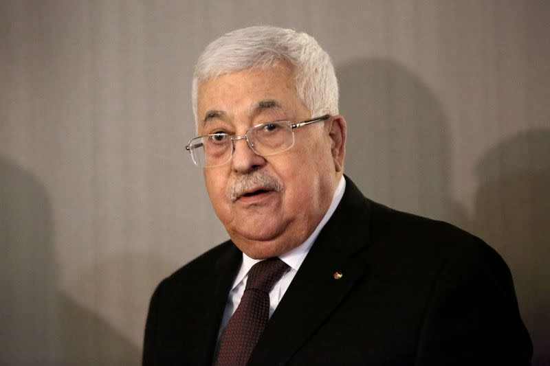 Palestinian President Mahmoud Abbas and former Israeli Prime Minister Ehud Olmert hold a news conference in New York