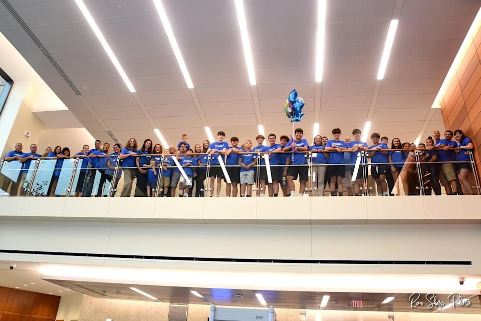 Community members in matching blue t-shirts showed up to Bucks County Courthouse to support Nate on his adoption day. (Courtesy Ron Sherr Photography)