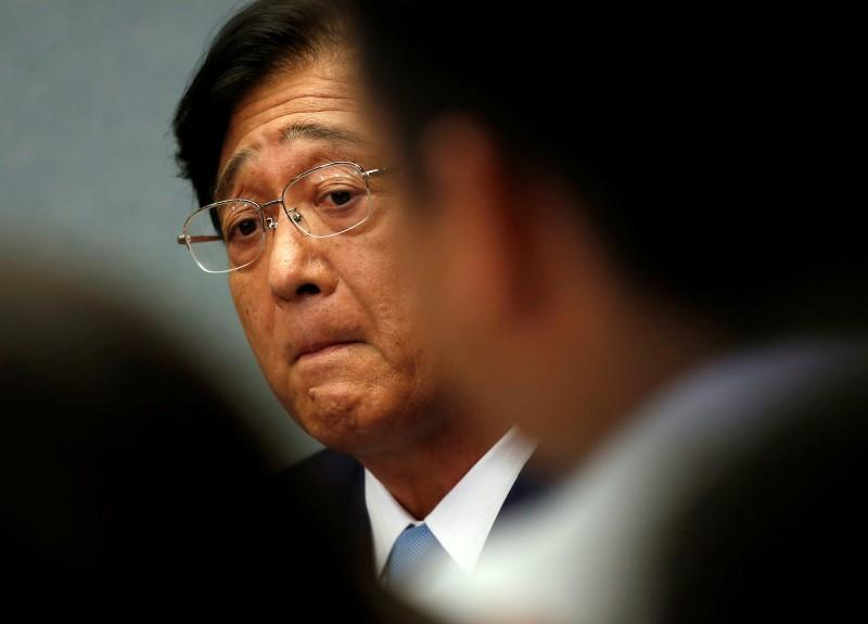 Mitsubishi Motors Corp.'s Chairman and CEO Osamu Masuko listens to a reporter's question at the Land, Infrastructure, Transport and Tourism Ministry in Tokyo, Japan