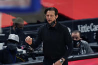 Utah Jazz head coach Quin Snyder looks on from the sideline during the first half of an NBA basketball game against the Detroit Pistons, Sunday, Jan. 10, 2021, in Detroit. (AP Photo/Carlos Osorio)