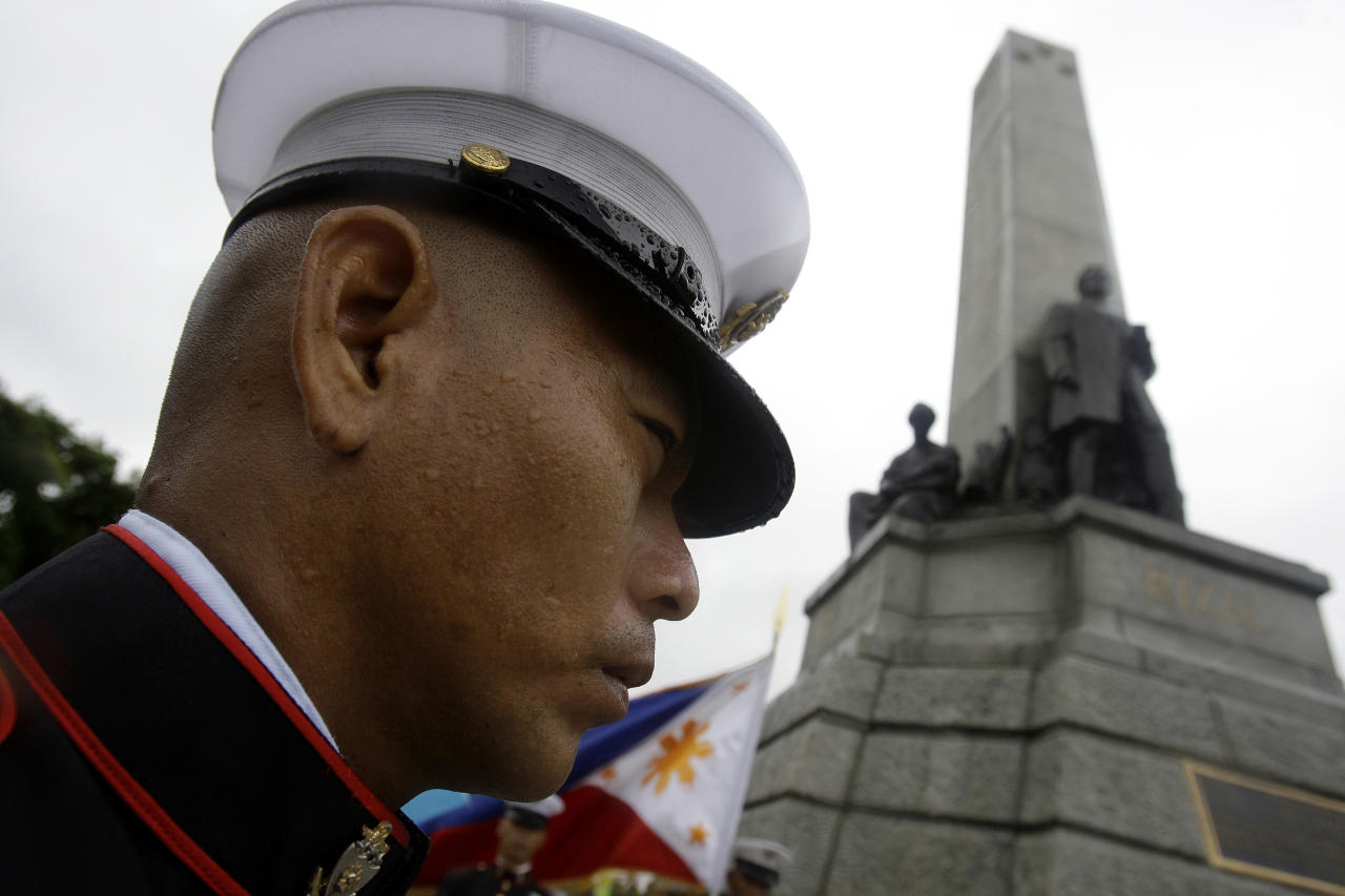 A Filipino soldier stands beside the monument of Jose Rizal during ceremonies to celebrate his 150th birthday in Manila, Philippines on Sunday June 19, 2011. Rizal is the country's national hero. (AP Photo/Aaron Favila)