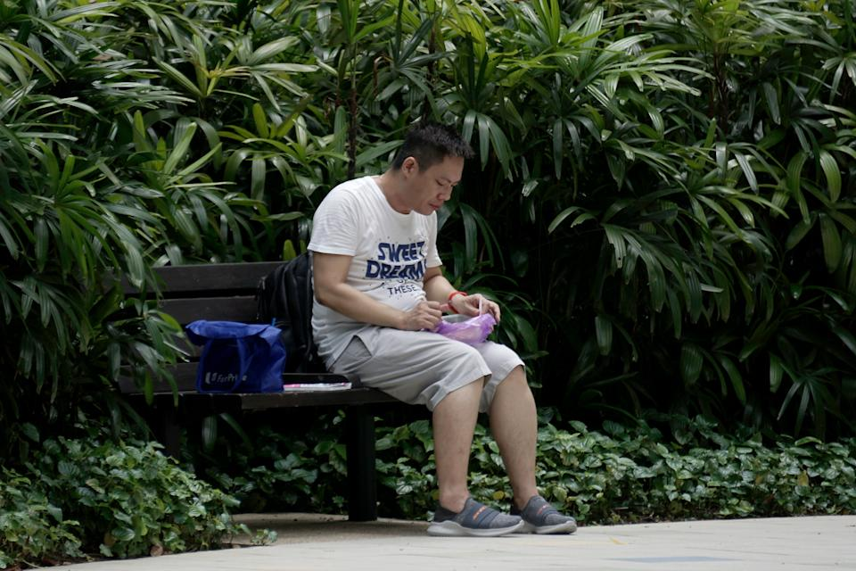 A man seen having his lunch at Telok Ayer Park on 7 April 2020, the first day of Singapore's month-long circuit breaker period. (PHOTO: Dhany Osman / Yahoo News Singapore)
