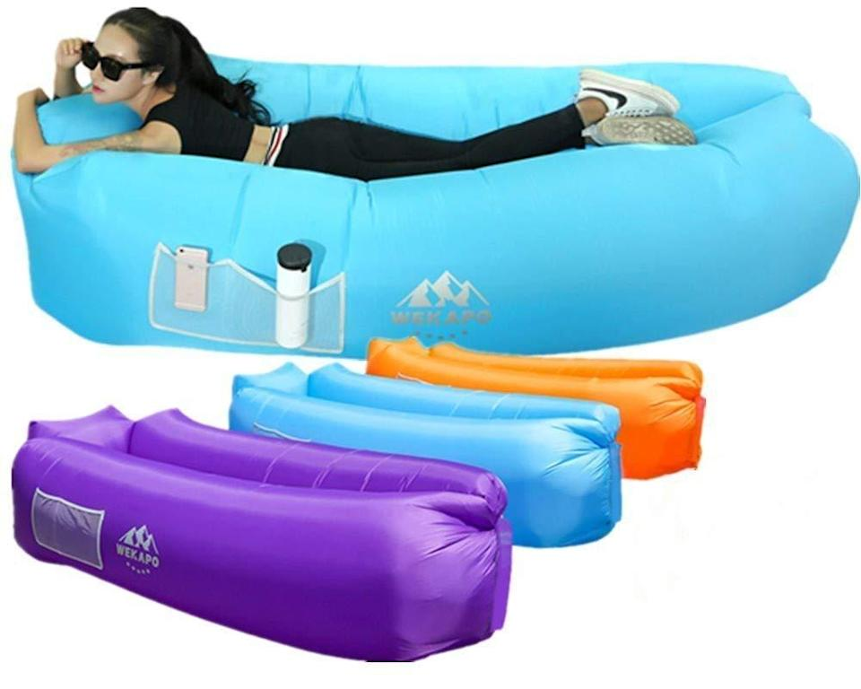 """<h3><h2>WEKAPO Inflatable Lounger</h2></h3><br>We are ready to sacrifice looking absolutely extra for the sheer comfort and convenience that this inflatable, waterproof air sofa has to offer. Past purchasers call it, """"Super easy to use and sooo comfy. Lightweight and doesn't stick and you can float in the water. Best beach 'chairs' by far due to the comfort and ease of packing.""""<br><br><em>Shop</em> <a href=""""https://amzn.to/3w1tRf2"""" rel=""""nofollow noopener"""" target=""""_blank"""" data-ylk=""""slk:WEKAPO"""" class=""""link rapid-noclick-resp""""><strong><em>WEKAPO</em></strong></a><br><br><strong>WEKAPO</strong> Inflatable Lounger, $, available at <a href=""""https://www.amazon.com/dp/B073PVYF7C/ref=sspa_dk_detail_0"""" rel=""""nofollow noopener"""" target=""""_blank"""" data-ylk=""""slk:Amazon"""" class=""""link rapid-noclick-resp"""">Amazon</a>"""