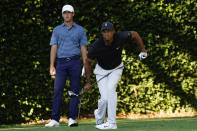 Andy Ogletree watches as Tiger Woods follows his tee shot on the second hole during the second round of the Masters golf tournament Friday, Nov. 13, 2020, in Augusta, Ga. (AP Photo/Matt Slocum)
