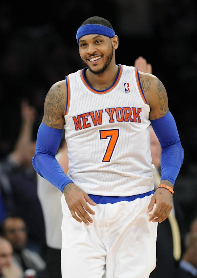 New York Knicks' Carmelo Anthony smiles after hitting a 3-point shot during the third quarter of an NBA basketball game against the Charlotte Bobcats, Friday, Jan. 24, 2014 at Madison Square Garden in New York. Anthony scored 62 points as the Knicks won 125-96. (AP Photo/Bill Kostroun)