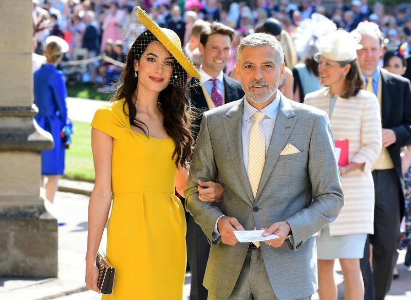 George and Amal at Meghan and Harry's wedding last year More