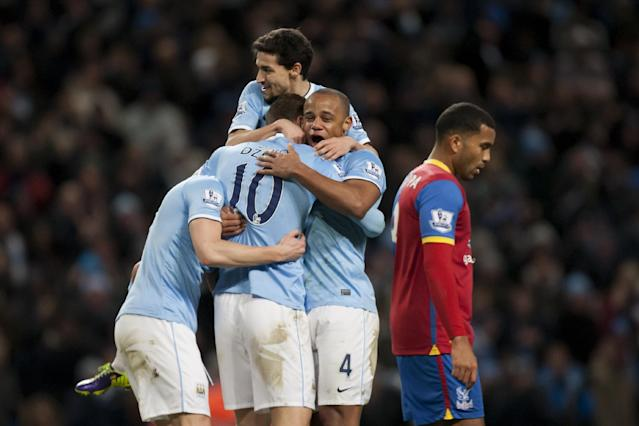 Manchester City's Edin Dzeko, second left, celebrates with teammates after scoring against Crystal Palace during their English Premier League soccer match at the Etihad Stadium, Manchester, England, Saturday Dec. 28, 2013. (AP Photo/Jon Super)