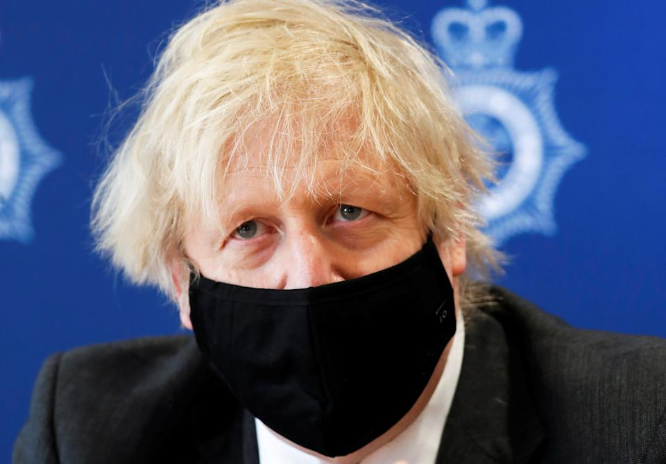 Britain's Prime Minister Boris Johnson visits South Wales Police Headquarters in Bridgend, South Wales, Britain February 17, 2021. Alastair Grant/Pool via REUTERS
