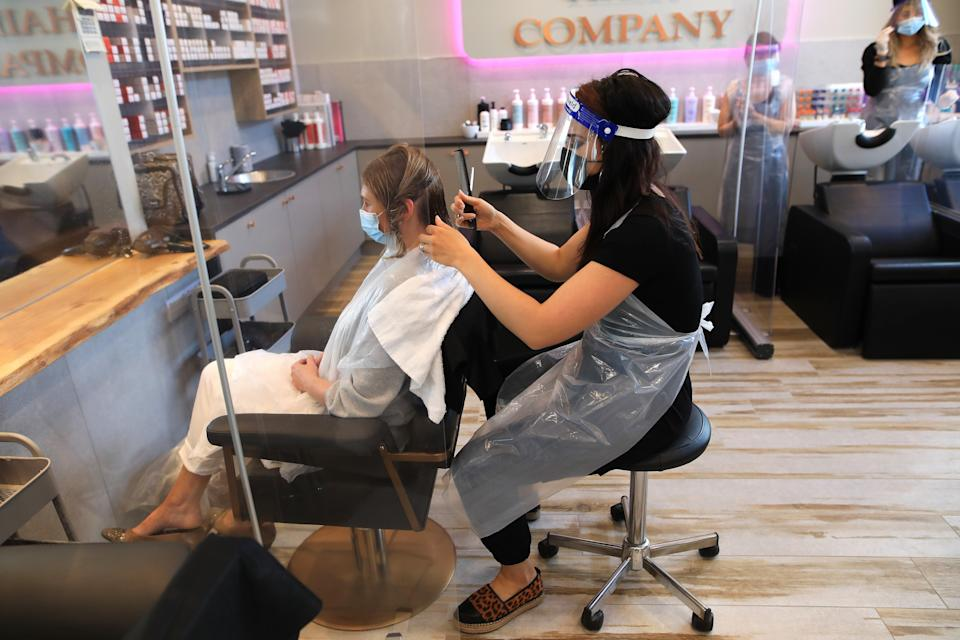 Juliette Menown gets her hair cut by stylist Sophie Alexandra at Natural Hair Company in Lisburn (PA) (PA Wire)