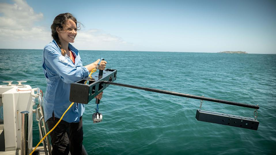 Researcher Naima Andrea Lòpez with mid-water BRUVS (Blue Abacus/PA)
