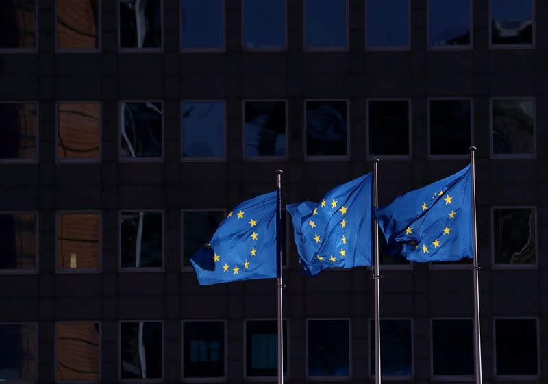 FILE PHOTO: European Union flags fly outside the European Commission headquarters in Brussels