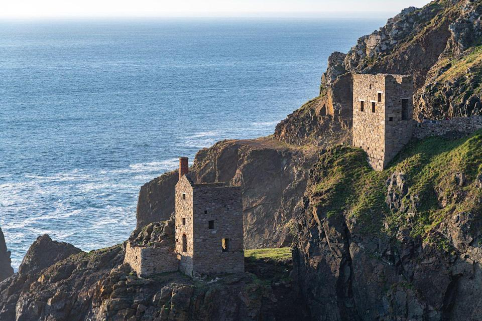 """<p>Fans of Poldark will recognise this National Trust site from the hit series, which was used as a stand-in for the family's tin mines. Part of the rugged Tin Coast, it's an incredible place to discover Britain's early industrial past, as well as soak up spectacular views. </p><p>The Crown Mines' old engine houses still remain, clinging to the cliffside, with the wild waves of the Atlantic Ocean crashing against the rocks below. Visit on a summer's evening to enjoy awesome sunsets at this truly atmospheric National Trust location.</p><p><strong>Where to stay: </strong><a href=""""https://go.redirectingat.com?id=127X1599956&url=https%3A%2F%2Fwww.booking.com%2Fhotel%2Fgb%2Fthe-old-post-house-st-just.en-gb.html%3Faid%3D2070935%26label%3Dnational-trust-cornwall&sref=https%3A%2F%2Fwww.countryliving.com%2Fuk%2Ftravel-ideas%2Fstaycation-uk%2Fg35461727%2Fnational-trust-cornwall%2F"""" rel=""""nofollow noopener"""" target=""""_blank"""" data-ylk=""""slk:The Old Post House B&B"""" class=""""link rapid-noclick-resp"""">The Old Post House B&B</a> is a cosy place to call home and has bikes to hire, as well as a relaxation room with yoga mats.</p><p><a class=""""link rapid-noclick-resp"""" href=""""https://go.redirectingat.com?id=127X1599956&url=https%3A%2F%2Fwww.booking.com%2Fhotel%2Fgb%2Fthe-old-post-house-st-just.en-gb.html%3Faid%3D2070935%26label%3Dnational-trust-cornwall&sref=https%3A%2F%2Fwww.countryliving.com%2Fuk%2Ftravel-ideas%2Fstaycation-uk%2Fg35461727%2Fnational-trust-cornwall%2F"""" rel=""""nofollow noopener"""" target=""""_blank"""" data-ylk=""""slk:CHECK PRICES"""">CHECK PRICES</a> </p>"""