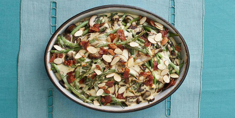"""<p>There's no canned soup in this recipe but making the classic holiday side dish from scratch is surprisingly easy to do—any time of the year. Top it with crispy bacon bits for even more delicious flavor. </p><p><strong><a href=""""https://www.thepioneerwoman.com/food-cooking/recipes/a33250059/green-bean-mushroom-casserole-with-candied-bacon-recipe/"""" rel=""""nofollow noopener"""" target=""""_blank"""" data-ylk=""""slk:Get Ree's recipe."""" class=""""link rapid-noclick-resp"""">Get Ree's recipe. </a> </strong></p>"""