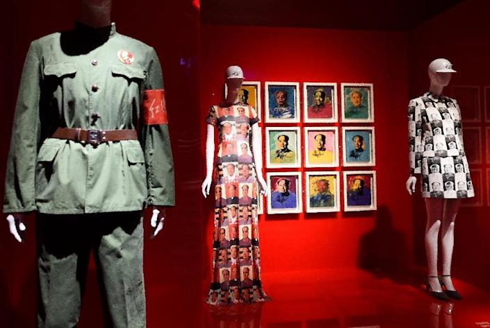 """Art work by Andy Warhol and a dress by Vivienne Tam are displayed as part of """"China Through the Looking Glass"""" on May 4, 2015 at the Metropolitan Museum of Art in New York (AFP Photo/Don Emmert)"""
