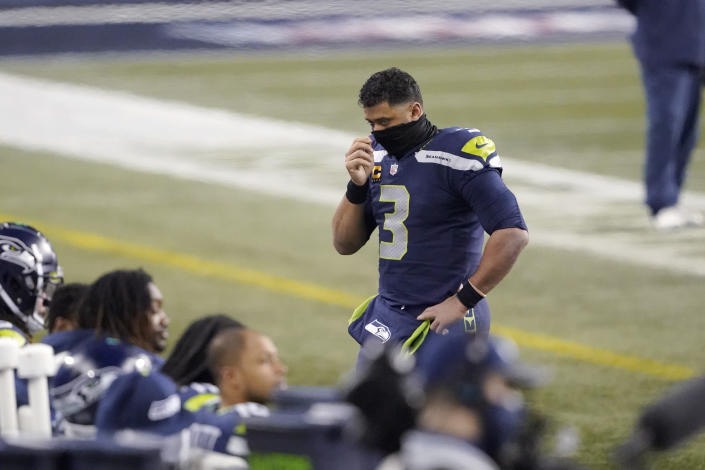 Seattle Seahawks quarterback Russell Wilson (3) looks toward his bench near the end of the second half of an NFL wild-card playoff football game against the Los Angeles Rams, Saturday, Jan. 9, 2021, in Seattle. (AP Photo/Ted S. Warren)