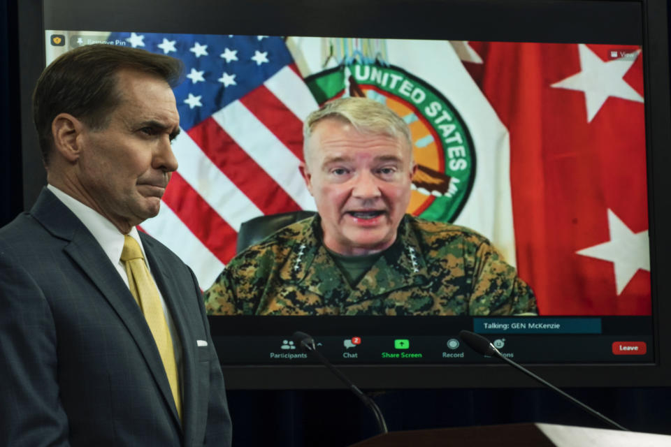 Gen. Frank McKenzie, Commander of the U.S. Central Command, speaks from MacDill Air Force Base, in Tampa, Fla., and appears on a screen as he speaks about the situation in Afghanistan during a virtual briefing moderated by Pentagon spokesman John Kirby at the Pentagon in Washington, Monday, Aug. 30, 2021. (AP Photo/Manuel Balce Ceneta)