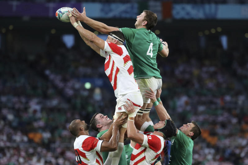 Ireland's Iain Henderson, right, and Japan's Luke Thompson, left, vie for a lineout during the Rugby World Cup Pool A game at Shizuoka Stadium Ecopa between Japan and Ireland in Shizuoka, Japan, Saturday, Sept. 28, 2019. (AP Photo/Eugene Hoshiko)