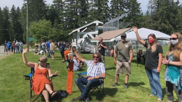 Supporters for forestry workers on Vancouver Island gathered near Lake Cowichan on Saturday to show support for the industry and RCMP officers.