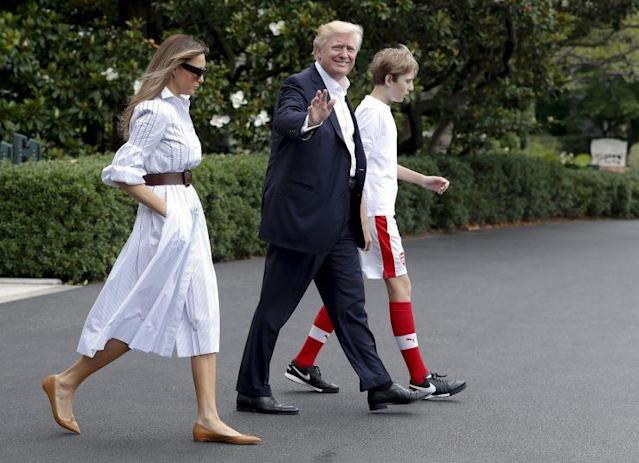 Melania, Donald, and Barron Trump leave the White House to travel to Camp David in Maryland. (Photo: AP)