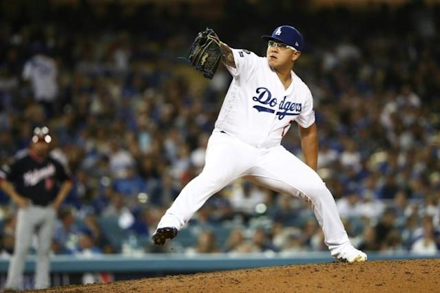 Los Angeles Dodgers relief pitcher Julio Urias would be among the hurlers who must retire the opposing side or face a minimum of three batters under a rule change announced Wednesday by Major League Baseball (AFP Photo/Sean M. Haffey)