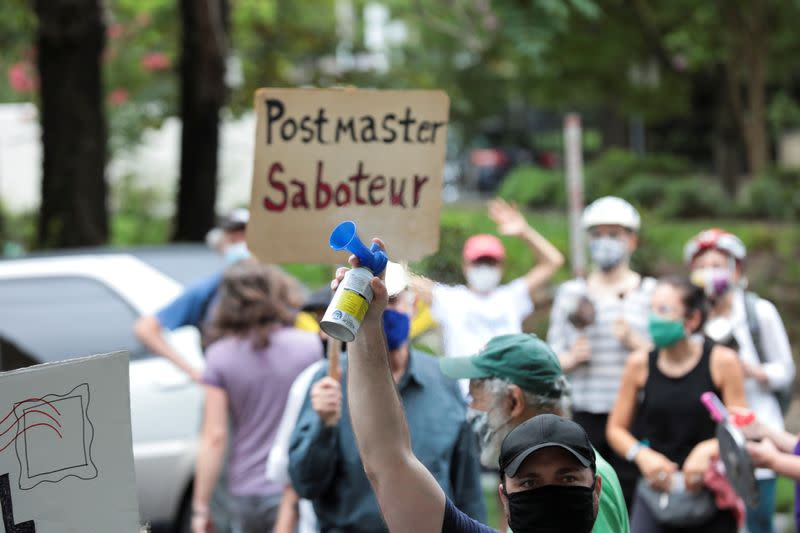 Protesters slam U.S. postmaster outside his home amid mail-in worries