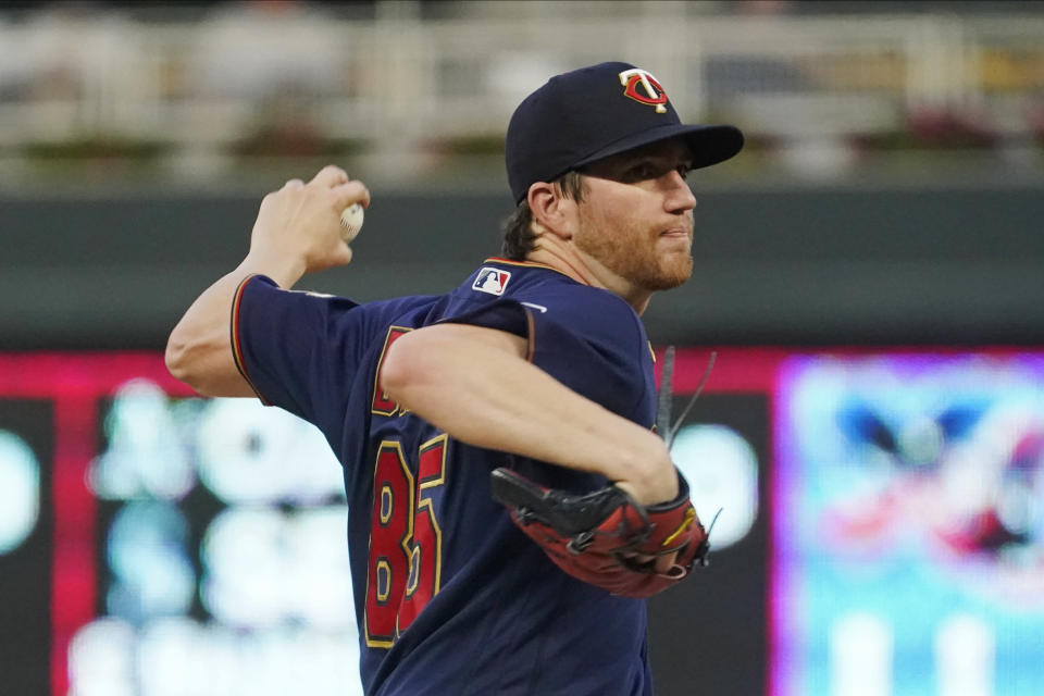 Minnesota Twins pitcher Charlie Barnes throws against the Detroit Tigers in the first inning of a baseball game, Tuesday, Sept. 28, 2021, in Minneapolis. (AP Photo/Jim Mone)