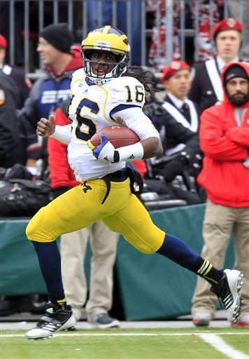 Michigan quarterback Denard Robinson breaks away on a 67-yard touchdown run against Ohio State in the second quarter of an NCAA college football game Saturday, Nov. 24, 2012, in Columbus, Ohio. (AP Photo/Jay LaPrete)