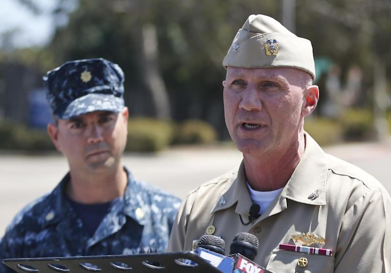 Captain Scott F. Adams, right, Commanding Officer Navy Base Point Loma, accompanied by Lt. Commander Steve Ruh, talks about an incident on the base in which a sailor was arrested for operating Airsoft weapon on the base Thursday, April 24, 2014, in San Diego. A second sailor who was a friend of the sailor with the weapon was also arrested. (AP Photo/Lenny Ignelzi)