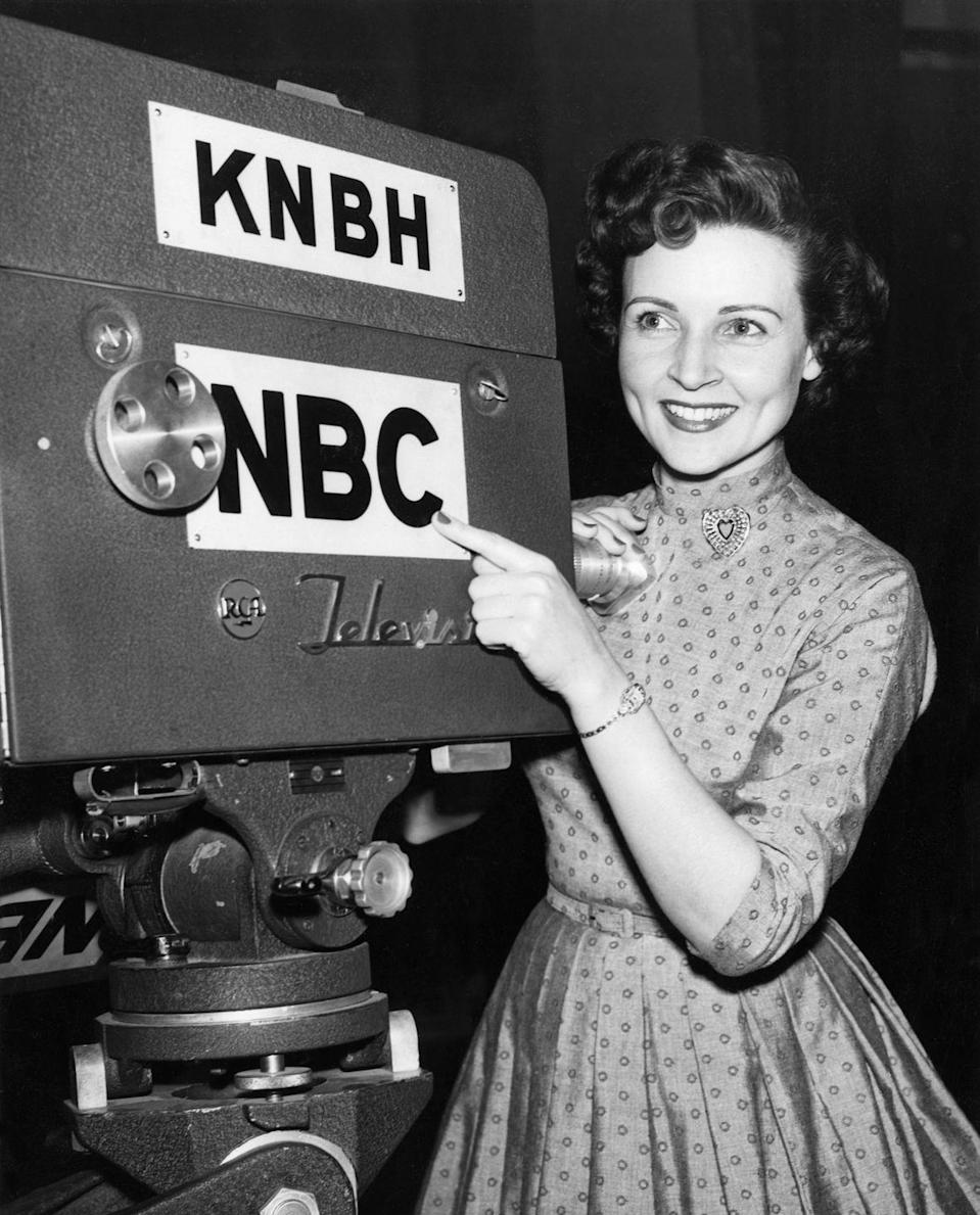 """<p>Betty's first break in the industry happened when Al Jarvis <a href=""""https://www.britannica.com/biography/Betty-White"""" rel=""""nofollow noopener"""" target=""""_blank"""" data-ylk=""""slk:asked her to be a &quot;Girl Friday&quot;"""" class=""""link rapid-noclick-resp"""">asked her to be a """"Girl Friday""""</a> for the new talk show <em>Hollywood on Television.</em></p>"""