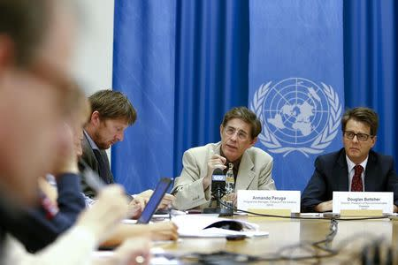 Armando Peruga (C), Programme Manager of Tobacco Free Initiative of the World Health Organization (WHO) and Douglas Bettcher (R), WHO's Director of the department for Prevention of Noncommunicable Diseases, speak during a press briefing at the United Nations in Geneva, August 26, 2014. REUTERS/Pierre Albouy