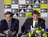 THIS PICTURE CAN ONLY BE USED WITHIN THE CONTEXT OF AN EDITORIAL FEATURE. NO WEBSITE/INTERNET USE UNLESS SITE IS REGISTERED WITH FOOTBALL ASSOCIATION PREMIER LEAGUE. Spurs executive vice-chairman David Buchler (left) talks to the press as Glenn Hoddle (right) is unveiled as Tottenham s new manager at White Hart Lane.