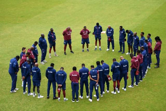 The West Indies team observe a moment of silence (Gareth Copley/PA)