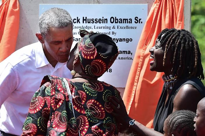 Obama unveiled a plaque during the opening of the Sauti Kuu Resource Centre in Kogelo founded by his half-sister (AFP Photo/TONY KARUMBA)