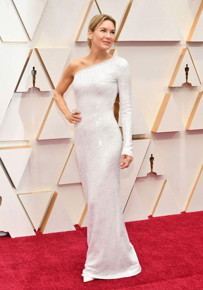 <p>Best Actress nominee Renee's sequinned, white, one-shouldered Armani Prive gown was one of the more simple styles of the night, but looked breathtaking. In fact, we'd say it's an iconic look for the actress. </p>