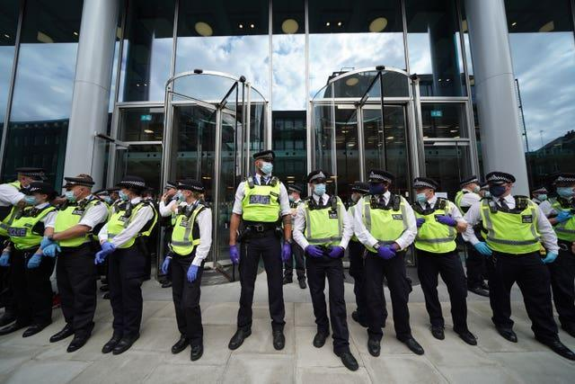 Police outside the offices of ITN