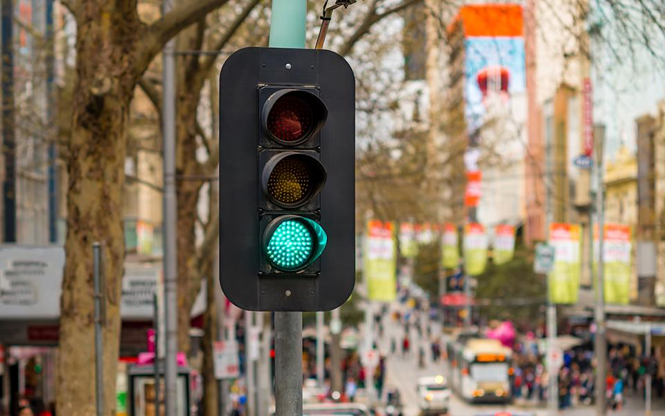 A traffic light with the green light on. Source: Getty Images