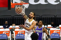 New Orleans Pelicans center Steven Adams, left, dunks as Sacramento Kings guard De'Aaron Fox (5) watches during the first quarter of an NBA basketball game in Sacramento, Calif., Sunday, Jan. 17, 2021. (AP Photo/Rich Pedroncelli)
