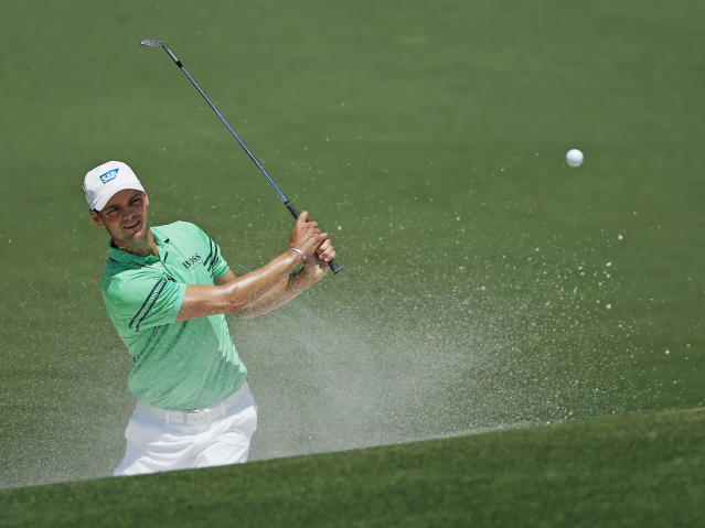 Martin Kaymer, of Germany, hits out of a bunker on the second hole during the fourth round of the Masters golf tournament Sunday, April 13, 2014, in Augusta, Ga. (AP Photo/Matt Slocum)