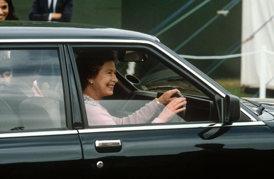 <p>Smiling broadly, the Queen drove away from the 1982 Windsor Horse Show. </p>