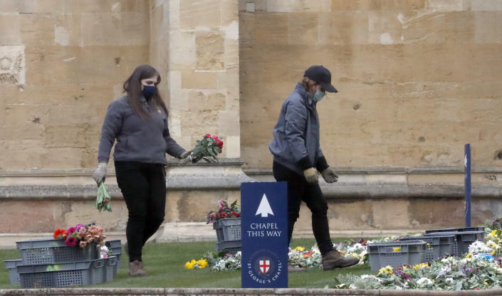 Collected flowers are placed on the lawn inside Windsor Castle after the death of Britain's Prince Philip in Windsor, Sunday, April 11, 2021. Britain's Prince Philip, the irascible and tough-minded husband of Queen Elizabeth II who spent more than seven decades supporting his wife in a role that mostly defined his life, died on Friday. (AP Photo/Frank Augstein)