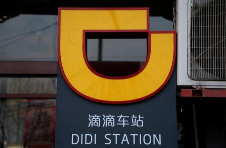 FILE PHOTO: The logo of Didi Chuxing is seen at a Didi station in Beijing