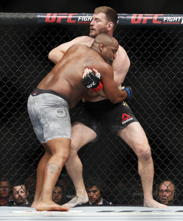 Daniel Cormier, left, fights Stipe Miocic in a heavyweight title mixed martial arts bout at UFC 226, Saturday, July 7, 2018, in Las Vegas. (AP Photo/John Locher)