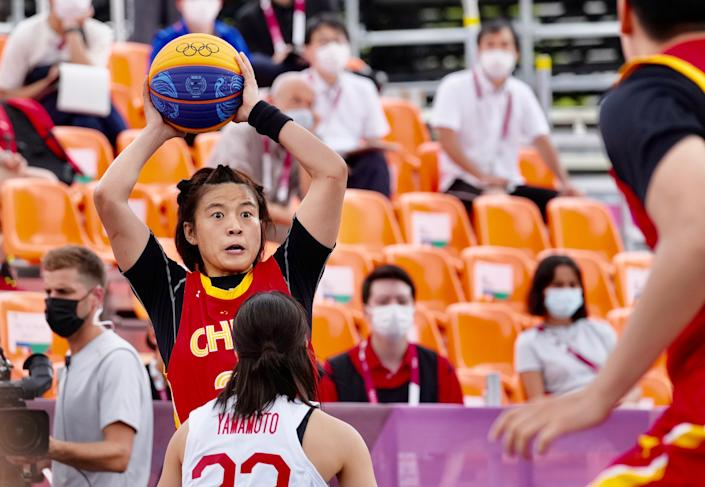 <p>TOKYO, JAPAN - JULY 26: Wang Lili of Team China handles the ball during a women's 3x3 basketball match between Japan and China on day three of the Tokyo 2020 Olympic Games at Aomi Urban Sports Park on July 26, 2021 in Tokyo, Japan. (Photo by Ni Minzhe/CHINASPORTS/VCG via Getty Images)</p>