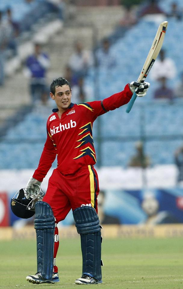 Quinton de Kock celebrates his century during the Champions League T20 match between Lions and Otago Volts at Sawai Mansingh Stadium, Jaipur on Sept. 29, 2013. (Photo: IANS)