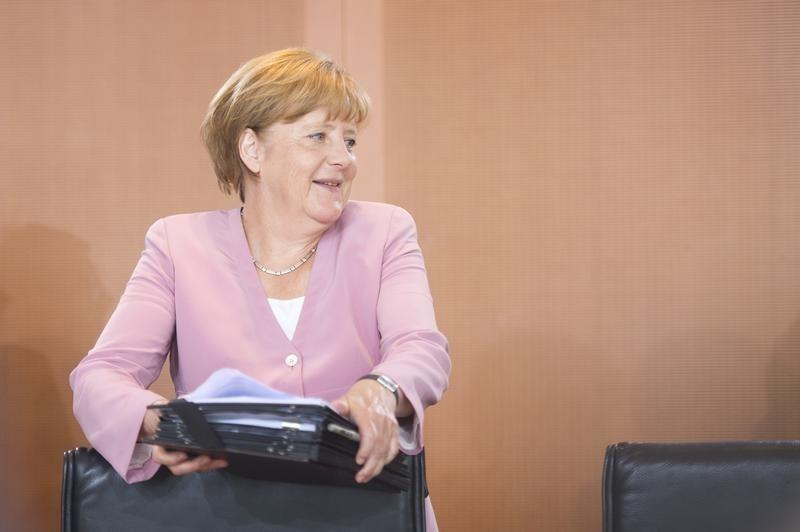 German chancellor Merkel reacts as she arrives for the weekly cabinet meeting at the chancellery in Berlin