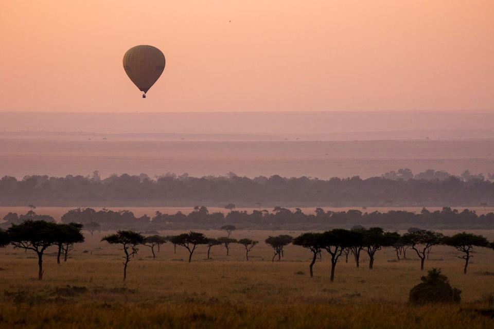 """<p>Perched (and seemingly suspended) above the dramatic Masai Mara game reserve in Kenya sits the intimate and exceedingly luxurious <a rel=""""nofollow noopener"""" href=""""https://www.angama.com/"""" target=""""_blank"""" data-ylk=""""slk:Angama Mara"""" class=""""link rapid-noclick-resp"""">Angama Mara</a>. Spread out on one of the most dramatic stretches in the world, The North and South Camps comprise elegant, spacious tents, all with views that will leave you inspired and energized (although tent #7 might win out as a favorite). </p><p>Overlooking the iconic site of the <em>Out of Africa</em> film, this gem was literally built with the best views in mind. Just a short drive by Land Rover Defender, you can experience some of the best animal spotting and game drives in Africa, where you may even see The Big 5 on your first day. From the property's dramatic position, take binoculars or try the telescope and you will see elephants gently grazing, prides of female lions sunbathing, and in the """"Green Season,'"""" watch the power of nature come alive with fleeting storms that roll in slowly from the distance and depart leaving things cooled down and lush. In fact, the """"Green Season"""" will grant you privileged access to some of the best animal sightings in the world, which explains why <a rel=""""nofollow noopener"""" href=""""https://www.angama.com/experience/photography/"""" target=""""_blank"""" data-ylk=""""slk:photographers"""" class=""""link rapid-noclick-resp"""">photographers</a> flock to Angama Mara for the views and access to the natural world. </p><p>Pro tip: take in the <em>Out of Africa</em> views by hot air balloon and 'forage' for your lunch in the organic garden overlooking the valley below–best enjoyed with crisp rose in hand. Notably, Angama Mara hosts Sundowners at least once during your stay, where in a setting overlooking the picnic spot made famous by the Meryl Streep and Robert Redford film, you can enjoy a Pimm's Cups as you unwind in camp chairs with cashmere blankets as the local Masai Men perform an ama"""