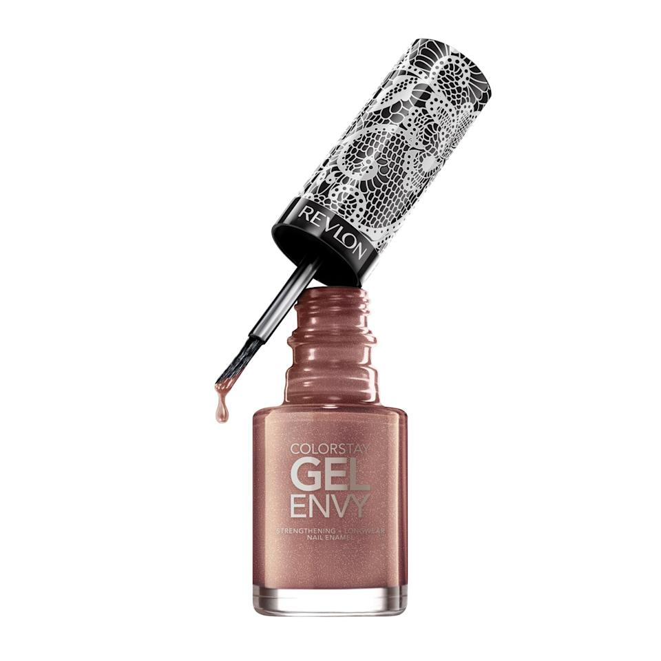 """<p>Revlon's Nail Polish in Corset Affair looks metallic-y copper in one light, a glittering amber in another, and iridescent gold if you catch the right angle. The chameleon polish from Ashley Graham's Revlon Gel Envy collection bottles up all the best colors of fall in a long-wear formula that will last noticeably longer (and chip-free) as compared to traditional polish.</p> <p><strong>$9</strong> (<a href=""""https://shop-links.co/1681832916524500017"""" rel=""""nofollow noopener"""" target=""""_blank"""" data-ylk=""""slk:Shop Now"""" class=""""link rapid-noclick-resp"""">Shop Now</a>)</p>"""