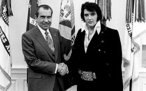 President Richard Nixon meets with Elvis Presley December 21, 1970 at the White House - Credit: National Archives/Getty Images