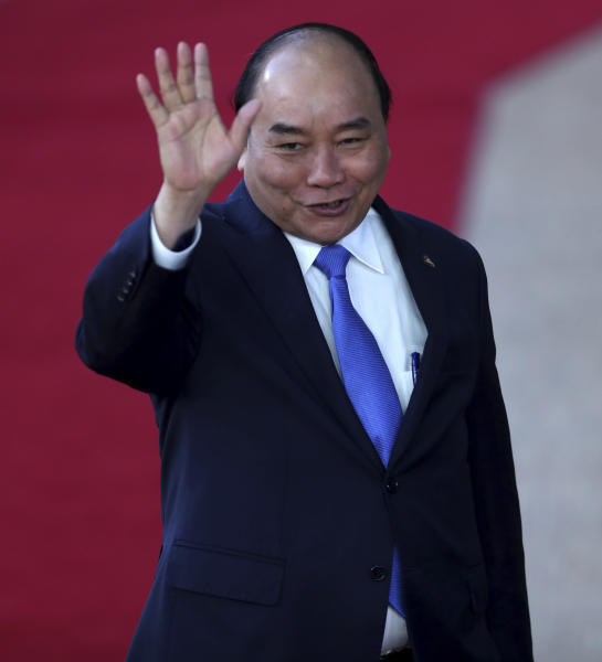 Vietnam's Prime Minister Nguyen Xuan Phuc arrives for the ASEM 12 in Brussels, Thursday, Oct. 18, 2018. The informal meeting, which is held every two years, will discuss peace moves on the Korean Peninsula, migration, cybersecurity, fighting extremism and combating climate change. (AP Photo/Francisco Seco)